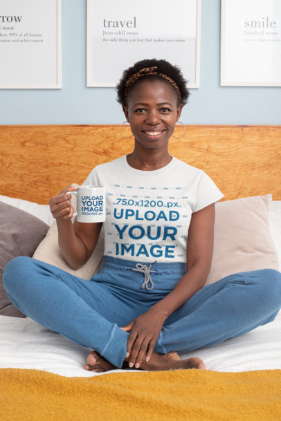 T-Shirt Mockup Featuring a Woman Sitting on the Bed Holding an 11 oz Coffee Mug 30330
