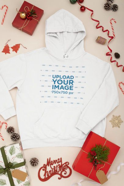 Mockup of a Pullover Hoodie with Christmas Decorations Around It 30635