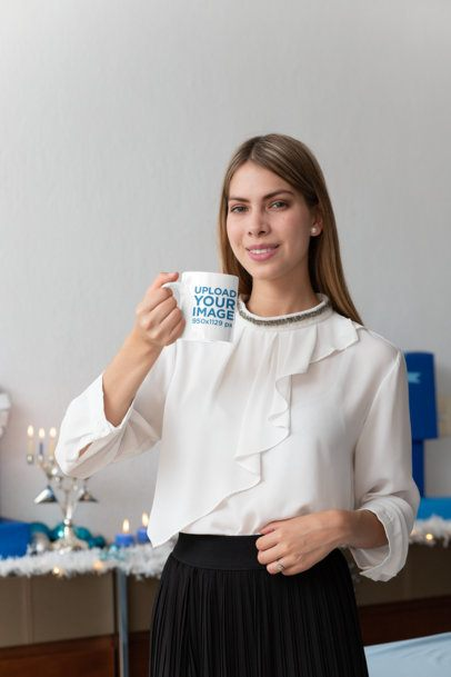 Mockup of a Woman with an 11 oz Coffee Mug at Hanukkah 30647