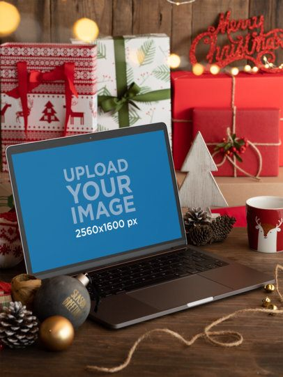 Mockup of a MacBook Pro Placed on a Christmas-Decorated Setting 30651