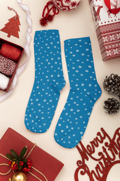 Mockup of a Pair of Socks Lying on a Christmas Decorated Surface 30640