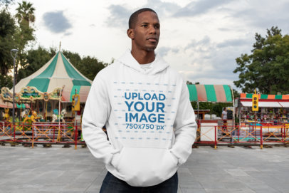 Pullover Hoodie Mockup of a Serious Man at a Fair 30455