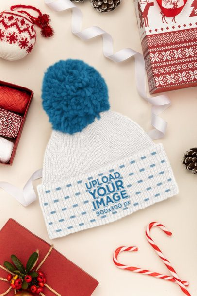 Mockup of a Beanie Surrounded by Christmas Decorations 30637