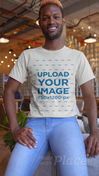 Stop Motion T-Shirt Video of a Young Man Smiling at the Camera 22535
