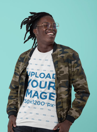 T-Shirt Mockup Featuring a Smiling Man with Retro Glasses at a Studio 30545