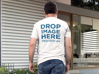 Mockup of a Senior Man Wearing a Tshirt while Walking Outdoors a11312b