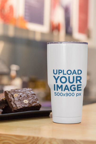 Mockup of a 30 oz Travel Mug Placed Next to Some Brownies 30416