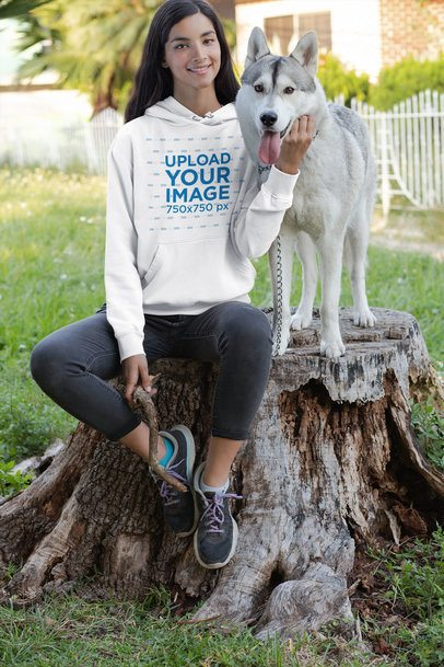 Mockup of a Young Woman with a Hoodie Petting Her Dog 30662