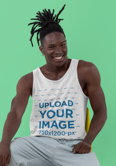 Tank Top Mockup Featuring a Man with Braids Sitting in a Studio 30552