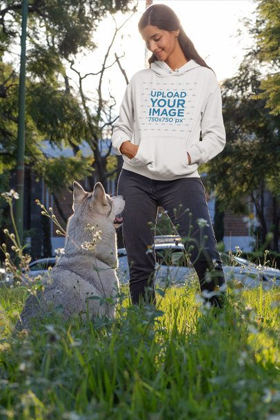 Pullover Hoodie Mockup of a Woman Looking at Her Dog 30663