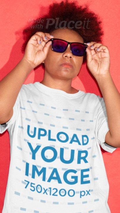 T-Shirt Video Featuring a Young Woman with Sunglasses Posing Against a Solid Color Background 22851