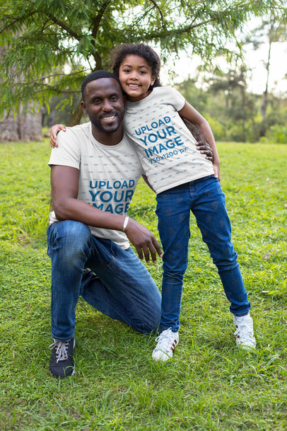 Mockup of a Dad and His Daughter Wearing Customizable T-Shirts in the Park 30596