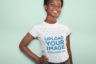 Mockup of a Woman with a T-Shirt Happily Posing at a Studio 30627