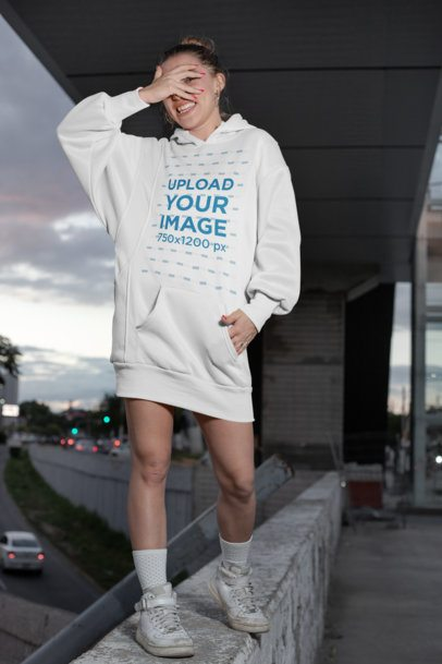 Mockup of a Happy Woman Wearing a Hoodie Dress in the Street 30575