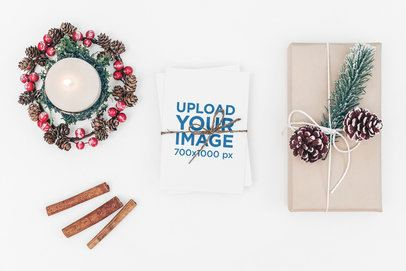 Christmas Card Mockup Featuring a Gift and Winter Decorations 1257-el
