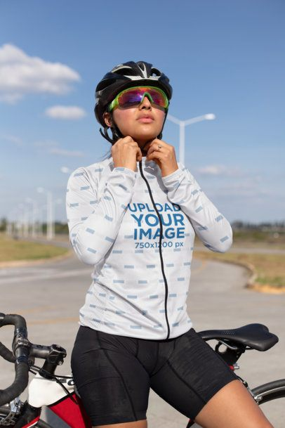 Cycling Jersey Mockup of a Woman Adjusting Her Helmet 30781