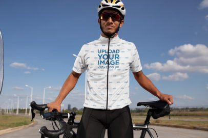 Short Sleeve Cycling Jersey Mockup Featuring a Man with a Helmet Holding His Bike 30783