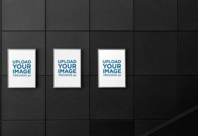 Mockup of Three Poster Frames at the Left of a Dark-Color Wall 1352-el