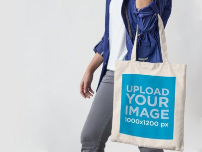 Mockup of a Canvas Tote Bag Being Carried by a Young Woman a11434