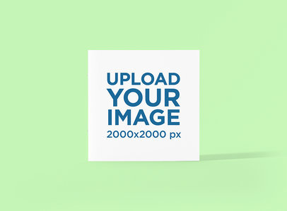 Mockup of a Square Booklet Standing Against a Plain Color Backdrop 1510-el