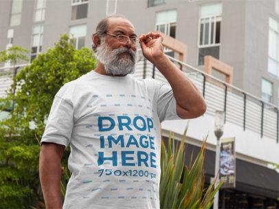T-Shirt Mockup of a Hispanic Senior Wearing Glasses a11095