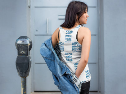 Girl Putting On a Denim Jacket Mockup Wearing a Sublimated Tank Top Mockup a9539b