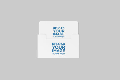 Mockup Featuring a Gift Card with Its Envelope Placed on a Solid Color Surface 1484-el