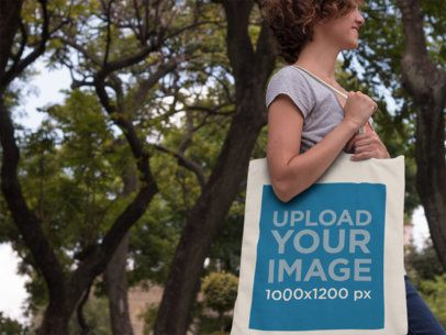 Canvas Tote Bag Mockup Featuring a Woman in a Park a11453