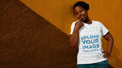 Stop Motion Video of a Woman with a T-Shirt Leaning on a Bicolor Wall 22998