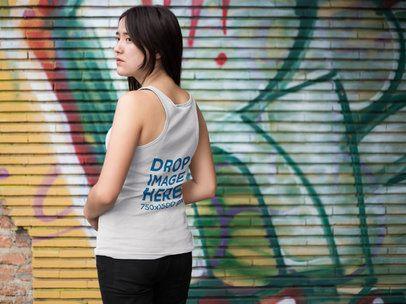 Back Shot Mockup of a Girl Wearing a Tank Top Near a Graffiti Painted Wall a9541b