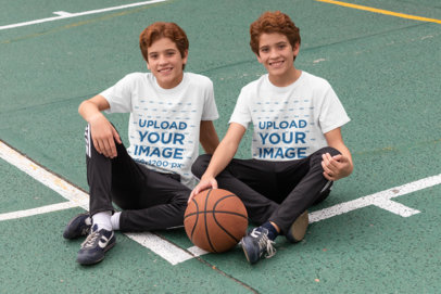 T-Shirt Mockup Featuring Two Red-Haired Twins at a Basketball Court 30690