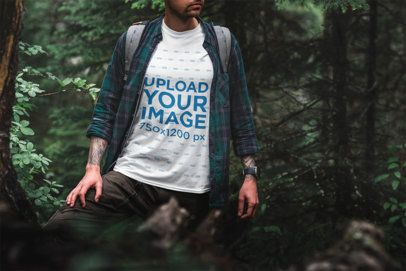 Mockup of a Man Wearing a Tee in a Forest Scenery 1853-el1