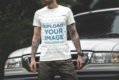 T-Shirt Mockup Featuring a Tattooed Man Standing in Front of a Truck 1836-el
