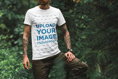 T-Shirt Mockup of an Adventurous Tattooed Man in Nature 1850-el1