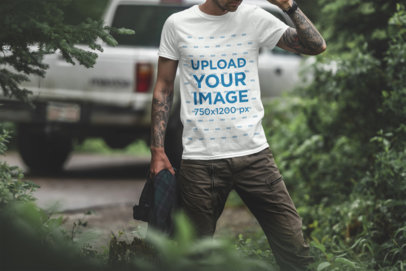 T-Shirt Mockup of a Tattooed Man in the Woods 1839-el
