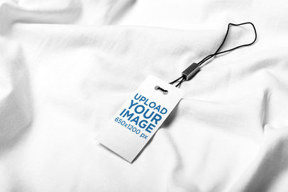 Mockup of a Brand Tag over a White Piece of Fabric 1802-el