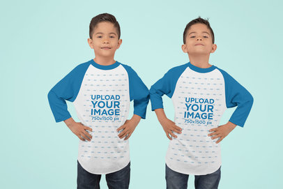 Mockup of Twin Boys Wearing Raglan T-Shirts at a Studio