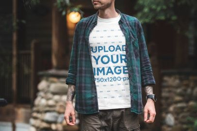Mockup of a Tattooed Man Wearing a T-Shirt Outside 1847-el1