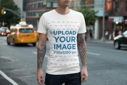 T-Shirt Mockup of a Tattooed Man Walking on the Street 1941-el