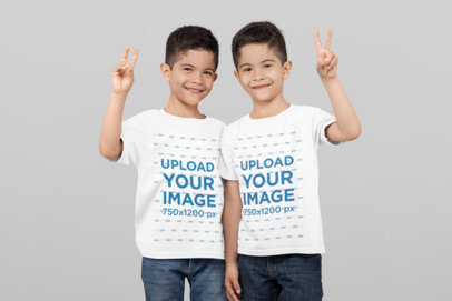 T-Shirt Mockup of Twin Boys Saying Hi at a Studio 31002