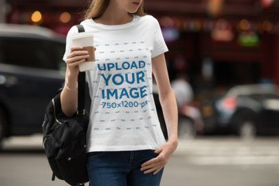 T-Shirt Mockup of a Woman Walking Down a Busy Street 1943-el1