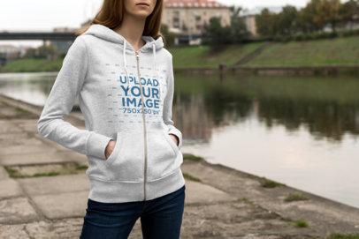 Full-Zip Hoodie Mockup of a Woman Standing by an Urban River 1784-el