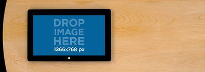 Microsoft Surface Over a Table Wide Shot Mockup a4784