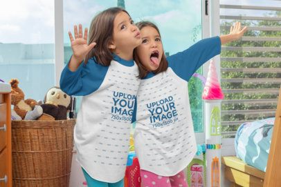 Raglan Tee Mockup of Twin Girls Making Funny Faces 31012