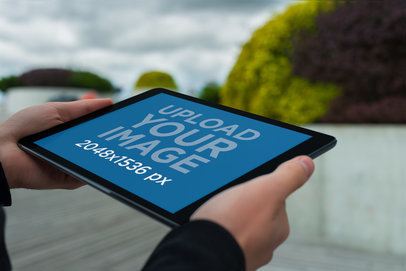 Mockup of a Man Holding an iPad in Landscape Position 2054-el