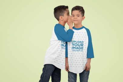Three-Quarter Sleeve Raglan T-Shirt Mockup Featuring a Boy Whispering to His Brother 30993