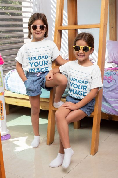 T-Shirt Mockup Featuring Identical Twin Girls at Their Bedroom 31019