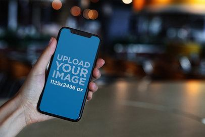iPhone 11 Pro Mockup Featuring Blurred Lights in the Background 2125-el1