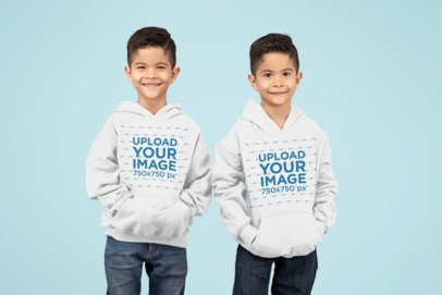 Pullover Hoodie Mockup Featuring Twin Brothers in a Studio 30998