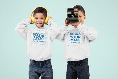 Hoodie Mockup of Twin Boys Playing with Headphones and a Camera 30999